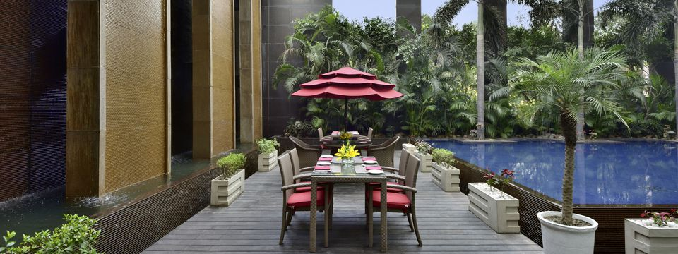 Outdoor dining area surrounded by beautiful waters and lush trees