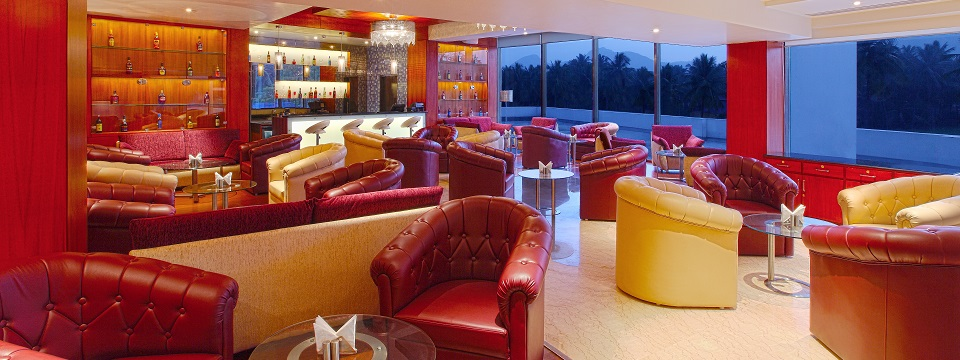Lounge area and bar with red and yellow chairs