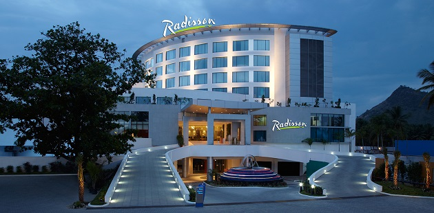 Exterior of Radisson Salem with fountain and lighted car rampp