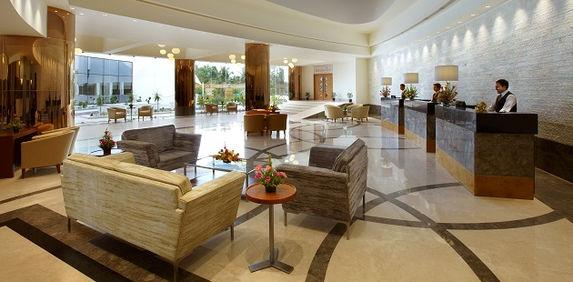 Spacious lobby with seating area and reception desks