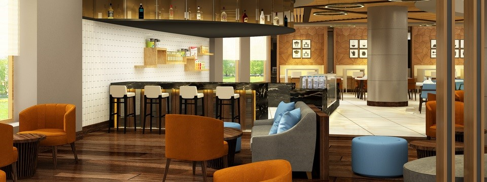 Bar surrounded by tables and chairs