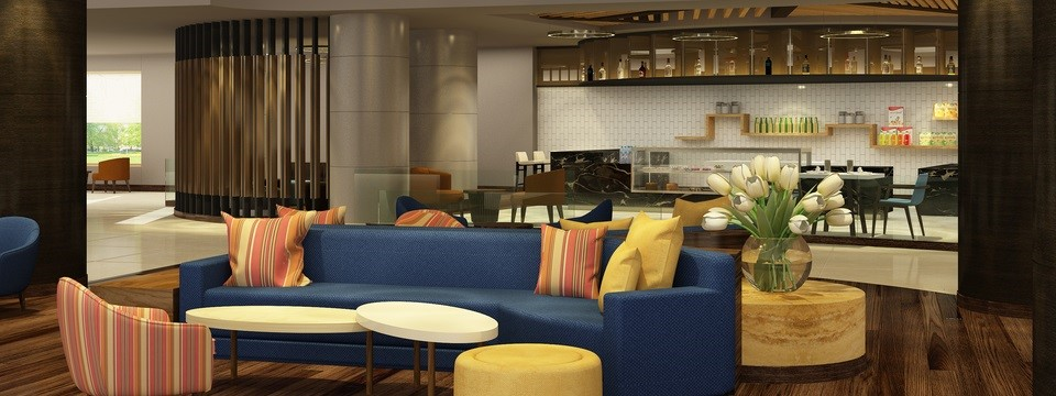 Hotel lobby with large blue sofa and attached dining area