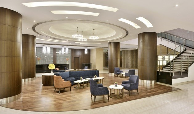 Hotel lobby with sofa, chairs and decorative light fixture