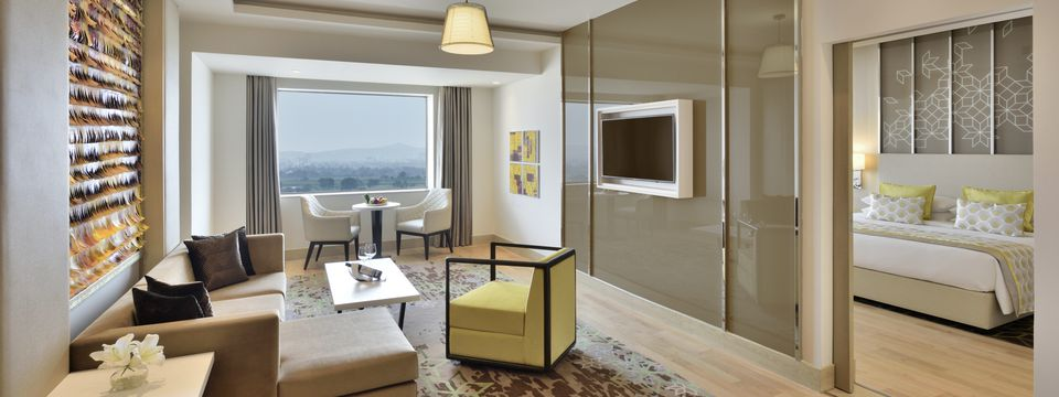Deluxe hotel suite featuring great views, a fully-furnished living room and private bedroom