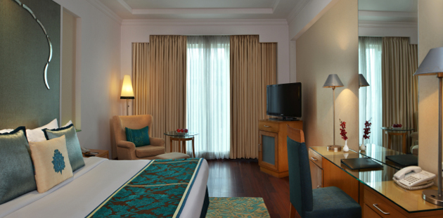 Deluxe Room with plush king bed and flat-screen TV