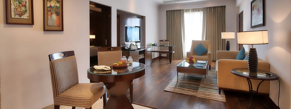 Hotel suite featuring a dining area and a fully-furnished living room