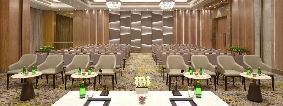 Banquet hall with plush chairs in lecture style setup