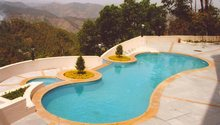 Outdoor multi-level pool surrounded by mountains