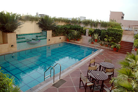 Swimming pool with decorative water fixture