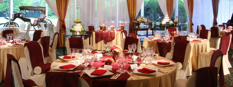 Floral Hall featuring round tables with gold and red linens