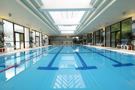 Indoor swimming pool with skylights at Radisson Narita