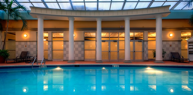 Indoor swimming pool with poolside seating available