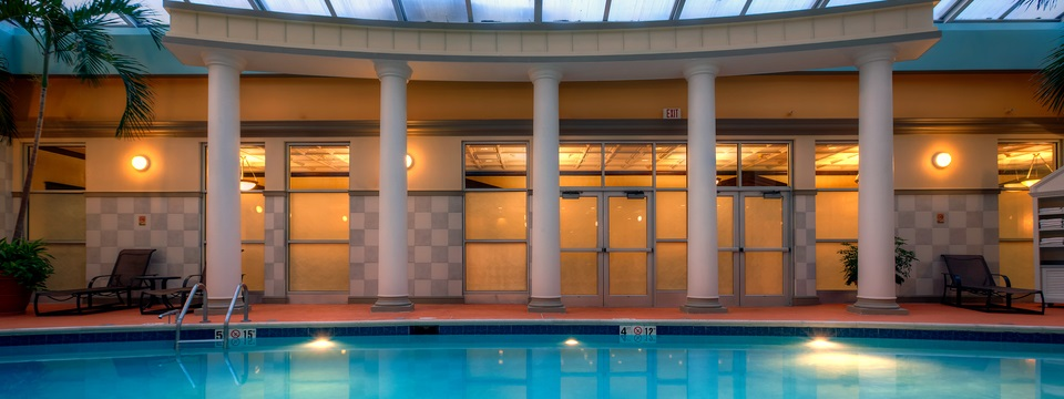 Indoor swimming pool and poolside seating