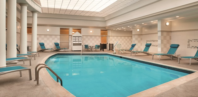 Indoor swimming pool with poolside seating