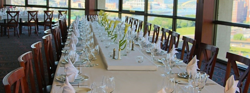 Formal meal setting at banquet table in revolving restaurant