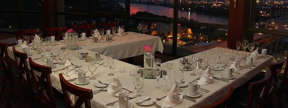City view from formally set table in revolving restaurant