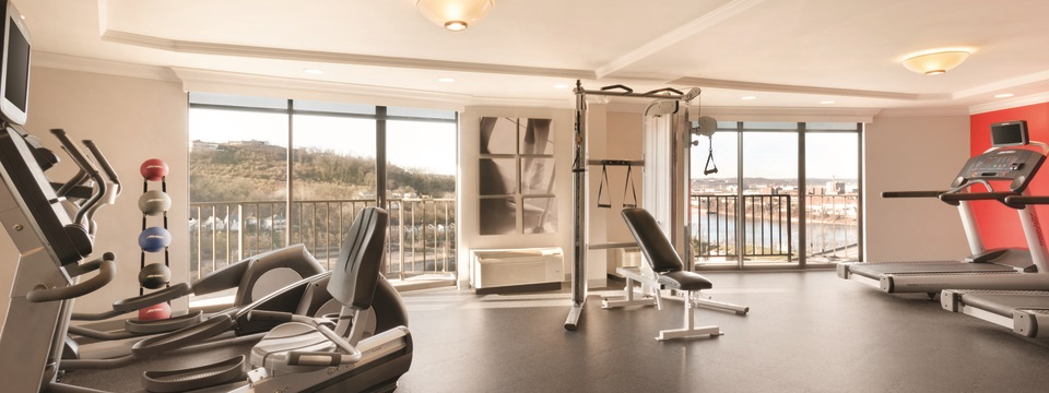 Cardio and strength training equipment in fitness center
