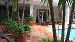 Poolside seating and patio at Covington hotel