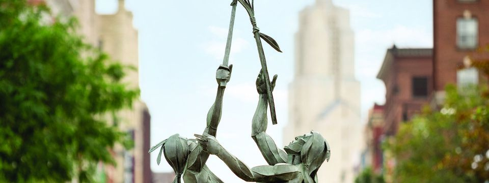 Statue of Native Americans playing lacrosse