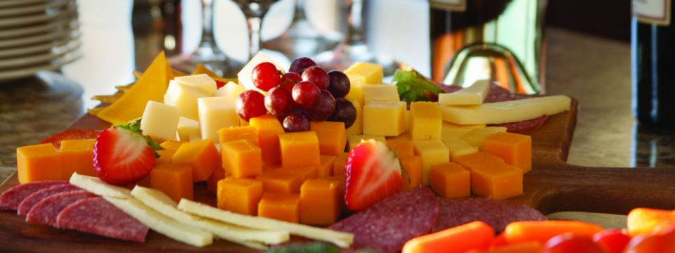 Cheese, fruit and meat plate with wine