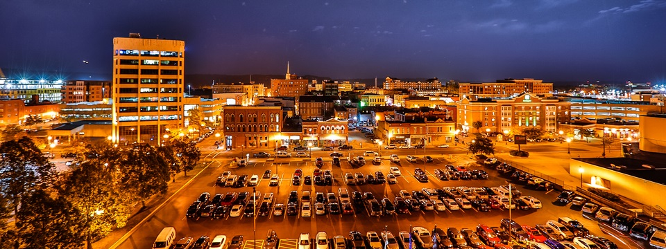 La Crosse at night with city view and parking lot