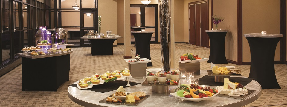 Display of cheese, fruit and desserts at event