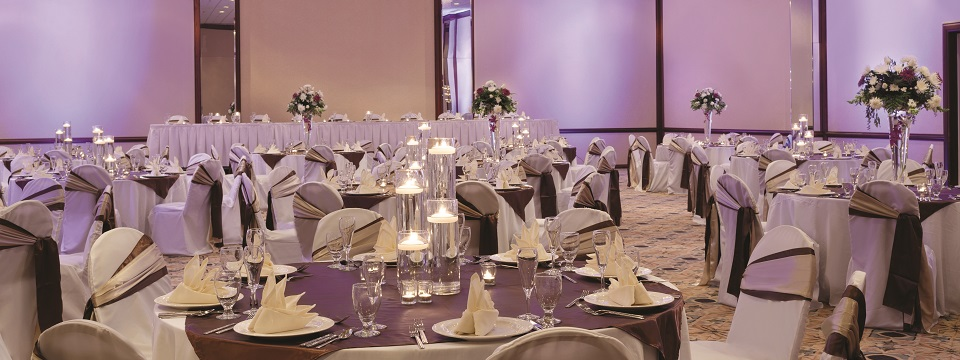 Decorated tables with linens, candles and glassware