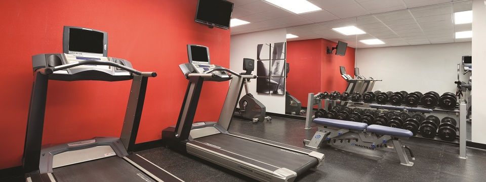 Fitness center with treadmills and free weights
