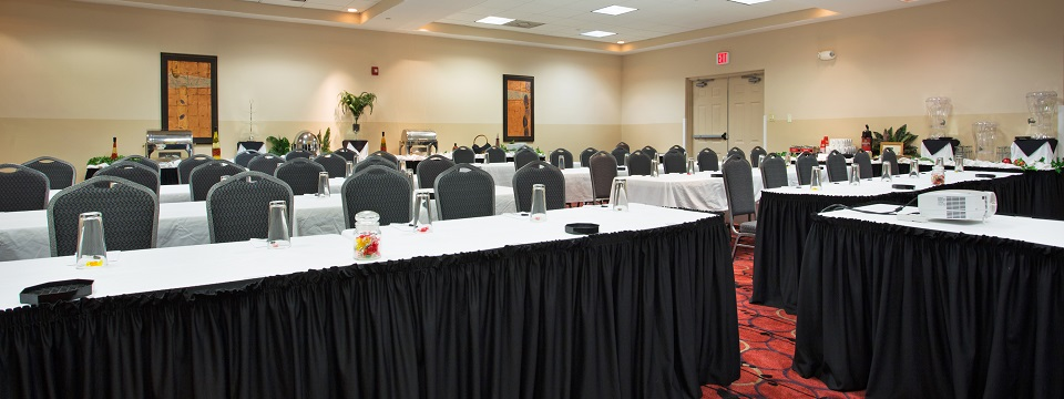 Tables and chairs set up in the meeting room