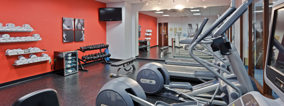 Fitness center with treadmills, free weights and towels