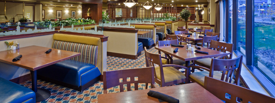 Hotel restaurant with rows of booths and tables