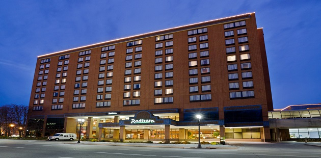 Exterior of the Radisson in downtown Lansing, MI at dusk