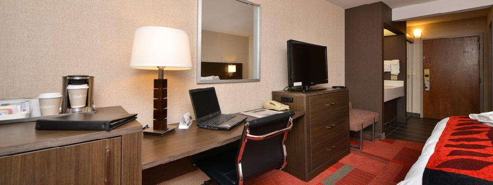 Business Class Room's work station with laptop
