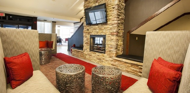 Hotel lobby with fireplace and large-screen TV