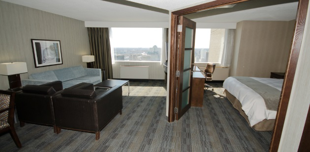 Hotel suite with separate living room and king bedroom