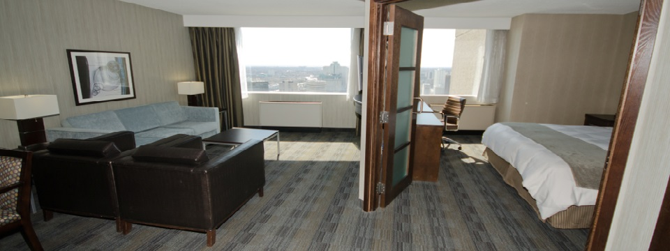 Hotel suite with separate bedroom and living room looking out onto Winnipeg