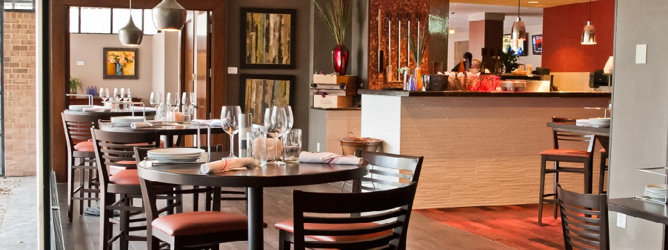 Round tables and modern lighting at Scoozi Ristorante