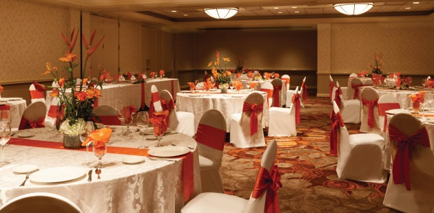 White Oak Ballroom featuring round tables with white and orange linens