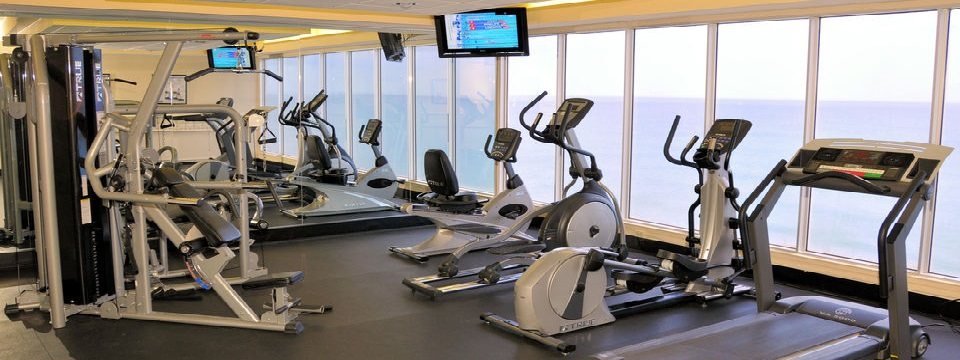 Fitness center with cardio equipment, weight machine and flat-screen TV