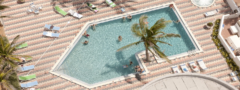 Top view of the outdoor pool surrounded by lounge chairs