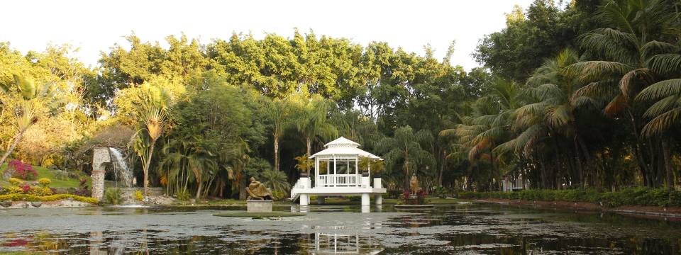 Regal white gazebo with a sculpture surrounded by water