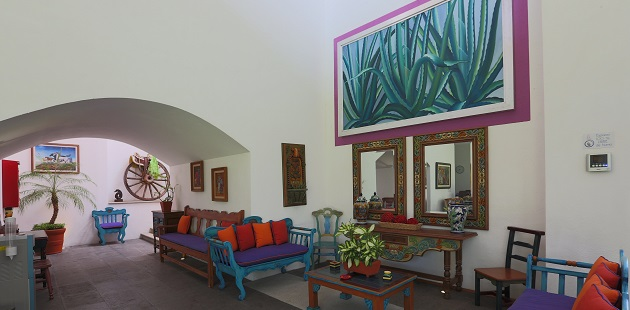 Lobby with colorful couches and dual mirrors