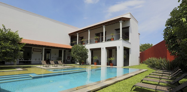 Cuernavaca hotel's outdoor pool with lounge chairs