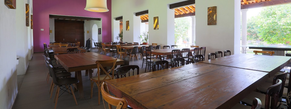 Restaurant dining area with wooden tables and chairs