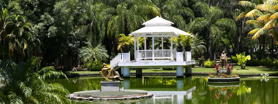 Gazebo and sculpture in center of lake
