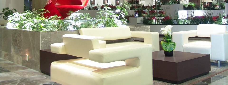 Modern lobby with white chairs and greenery