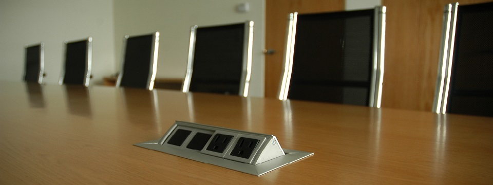 Meeting table with power outlet plugs
