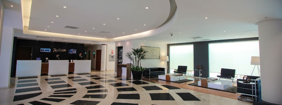 Modern lobby with black and white tile floor and seating