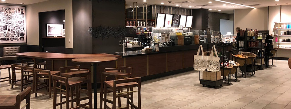 Starbucks coffee shop with merchandise displays and table seating