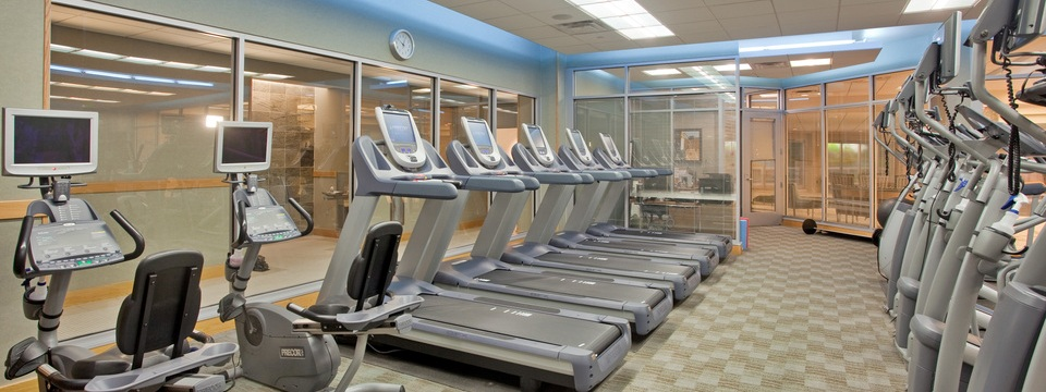 Fitness center equipment includes treadmills
